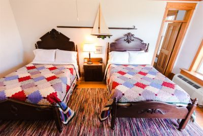 Two Full Beds and Nightstand in Room 2